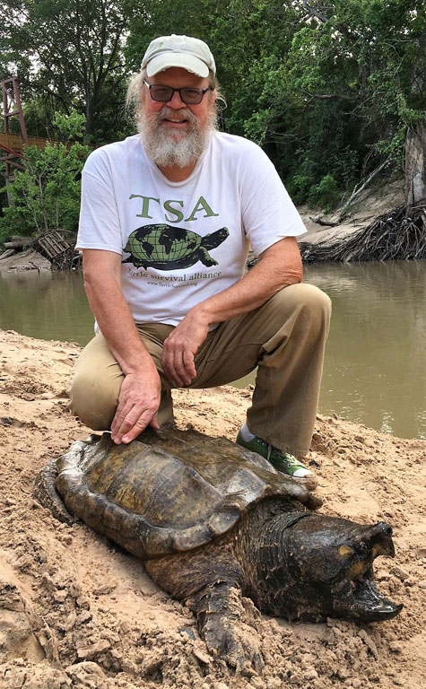 George Heinrich with an Alligator Snapping Turtle. (Photo: Jordan Gray)